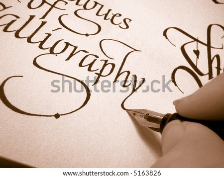 writing in calligraphy letter form on textured paper