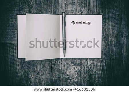 writing in diary, my dear diary , notebook diary on wooden table with pen ,retro style