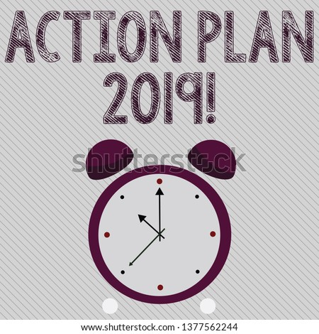 Writing note showing Action Plan 2019. Business photo showcasing proposed strategy or course of actions for current year Colorful Round Analog Two Bell Alarm Desk Clock with Seconds Hand photo.