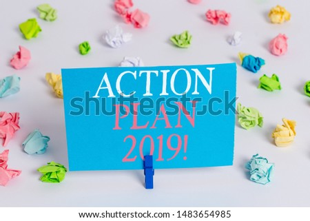 Writing note showing Action Plan 2019. Business photo showcasing proposed strategy or course of actions for current year Colored crumpled paper empty reminder white floor clothespin.
