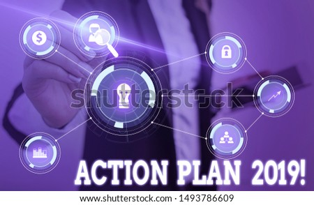 Writing note showing Action Plan 2019. Business photo showcasing proposed strategy or course of actions for current year Woman wear formal work suit presenting presentation using smart device.