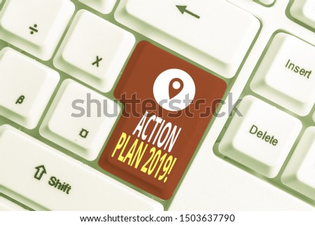 Writing note showing Action Plan 2019. Business photo showcasing proposed strategy or course of actions for current year White pc keyboard with note paper above the white background.