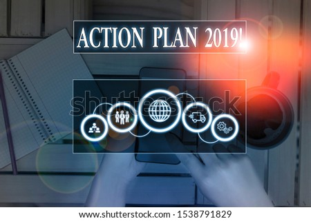 Writing note showing Action Plan 2019. Business photo showcasing proposed strategy or course of actions for current year Picture photo network scheme with modern smart device. #1538791829