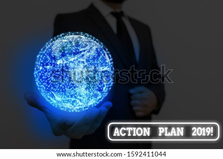 Writing note showing Action Plan 2019. Business photo showcasing proposed strategy or course of actions for current year Elements of this image furnished by NASA.