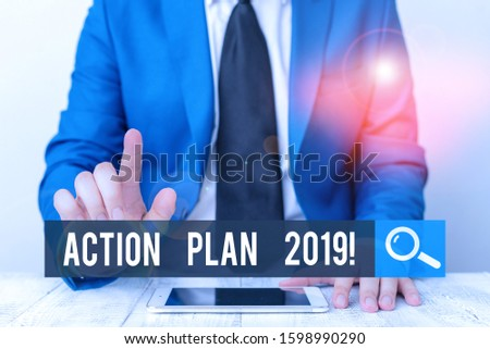 Writing note showing Action Plan 2019. Business photo showcasing proposed strategy or course of actions for current year Businessman with pointing finger in front of him.