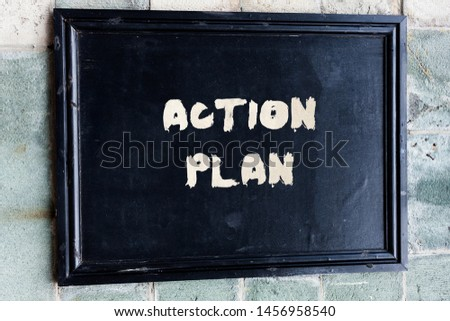 Writing note showing Action Plan. Business photo showcasing proposed strategy or course of actions for certain time. #1456958540