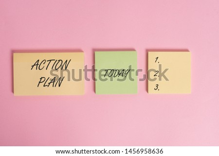 Writing note showing Action Plan. Business photo showcasing proposed strategy or course of actions for certain time Close up front view three multicolor blank notepads colored background. #1456958636
