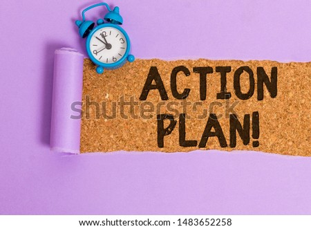 Writing note showing Action Plan. Business photo showcasing proposed strategy or course of actions for certain time.