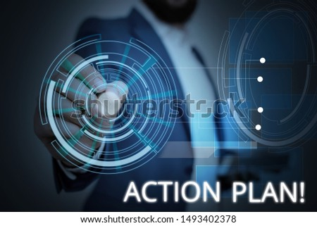 Writing note showing Action Plan. Business photo showcasing proposed strategy or course of actions for certain time Male wear formal suit presenting presentation smart device.