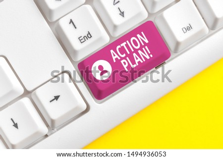 Writing note showing Action Plan. Business photo showcasing proposed strategy or course of actions for certain time White pc keyboard with note paper above the white background.