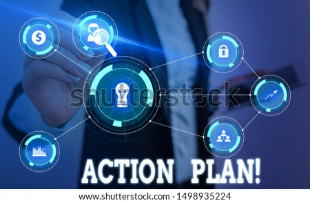 Writing note showing Action Plan. Business photo showcasing proposed strategy or course of actions for certain time Woman wear formal work suit presenting presentation using smart device.