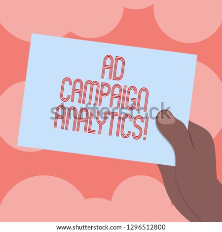 Writing note showing Ad Campaign Analytics. Business photo showcasing monitor campaigns and their respective outcomes Drawn Hu analysis Hand Holding Blank Color Paper Cardboard.