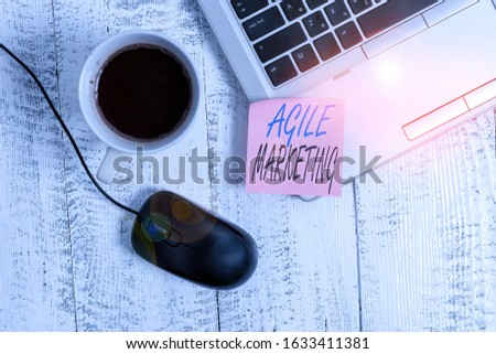 Writing note showing Agile Marketing. Business photo showcasing focusing team efforts that deliver value to the endcustomer Trendy metallic laptop blank sticky note coffee cup mouse lying vintage.
