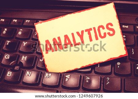 Writing note showing Analytics. Business photo showcasing systematic computational analysis of data statistics or infos Blank Bordered Notepad Reminding Inserted Between Keys of Laptop. #1249607926
