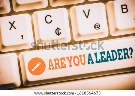 Writing note showing Are You ALeader Question. Business photo showcasing Set direction Create inspiring visions Motivate others Keyboard with note paper on white background key copy space.