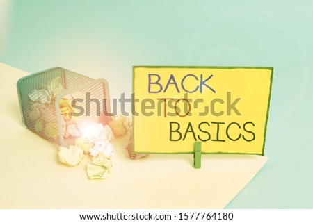 Writing note showing Back To Basics. Business photo showcasing Return simple things Fundamental Essential Primary basis Trash bin crumpled paper clothespin reminder office supplies.