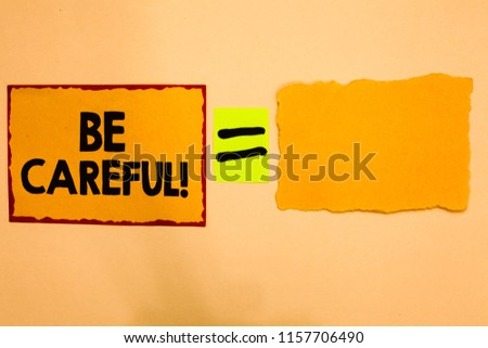 Writing note showing Be Careful. Business photo showcasing making sure of avoiding potential danger mishap or harm Orange paper notes reminders equal sign important messages to remember. #1157706490