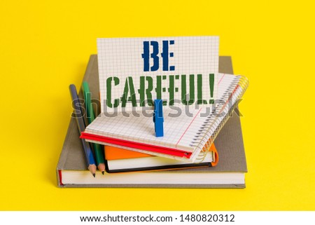 Writing note showing Be Careful. Business photo showcasing making sure of avoiding potential danger mishap or harm Book pencil rectangle shaped reminder notebook clothespins. #1480820312