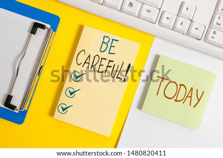 Writing note showing Be Careful. Business photo showcasing making sure of avoiding potential danger mishap or harm Paper with copy space and keyboard above orange background table. #1480820411