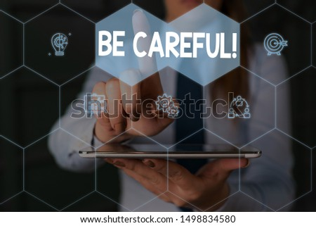 Writing note showing Be Careful. Business photo showcasing making sure of avoiding potential danger mishap or harm Woman wear formal work suit presenting presentation using smart device. #1498834580