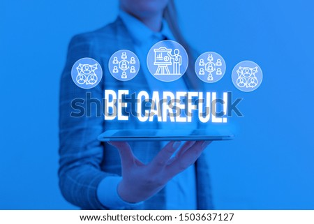 Writing note showing Be Careful. Business photo showcasing making sure of avoiding potential danger mishap or harm Woman wear formal work suit presenting presentation using smart device. #1503637127