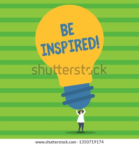 Writing note showing Be Inspired. Business photo showcasing fill someone with urge or ability to do or feel something Person Standing Arms Holding Big Yellow Lightbulb for Ideas.