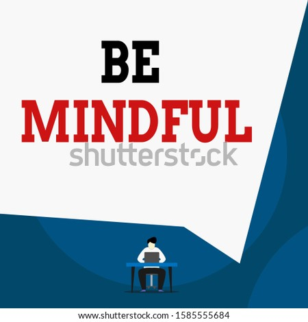 Writing note showing Be Mindful. Business photo showcasing paying close attention to or being conscious of something Man sitting chair desk working laptop geometric background.