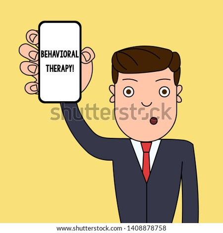 Writing note showing Behavioral Therapy. Business photo showcasing help change potentially selfdestructive behaviors Man Holding Vertical Smartphone Device Screen for Attention.