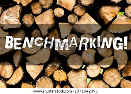 Writing note showing Benchmarking. Business photo showcasing evaluate something by comparison with standard or scores Wooden background vintage wood wild message ideas intentions thoughts. #1371042395