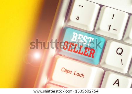 Writing note showing Best Seller. Business photo showcasing book or other product that sells in very large numbers White pc keyboard with note paper above the white background.