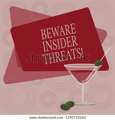 Writing note showing Beware Insider Threats. Business photo showcasing Be cautious on malicious attack inside the network Filled Cocktail Wine Glass with Olive on the Rim Text Space.