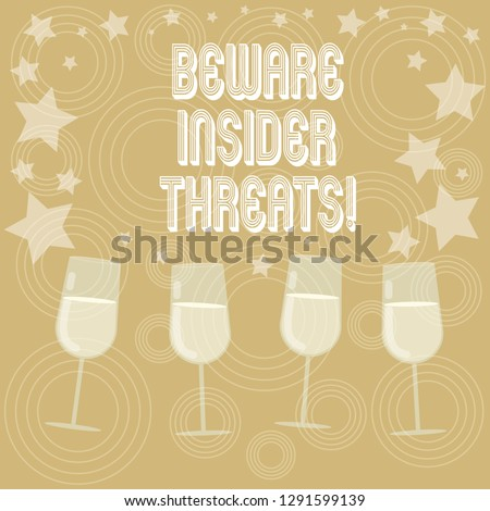 Writing note showing Beware Insider Threats. Business photo showcasing Be cautious on malicious attack inside the network Filled Cocktail Wine Glasses with Scattered Stars as Confetti Stemware.
