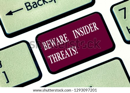 Writing note showing Beware Insider Threats. Business photo showcasing Be cautious on malicious attack inside the network Keyboard key Intention to create computer message pressing keypad idea. #1293097201