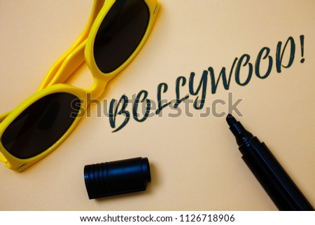 Writing note showing  Bollywood Motivational Call. Business photo showcasing Hollywood Movie Film Entertainment Cinema Ideas messages beige background black marker markers yellow sunglasses. #1126718906