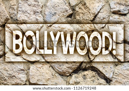 Writing note showing  Bollywood Motivational Call. Business photo showcasing Hollywood Movie Film Entertainment Cinema Ideas message stone stones rock rocks backgrounds wild natural pebbles. #1126719248