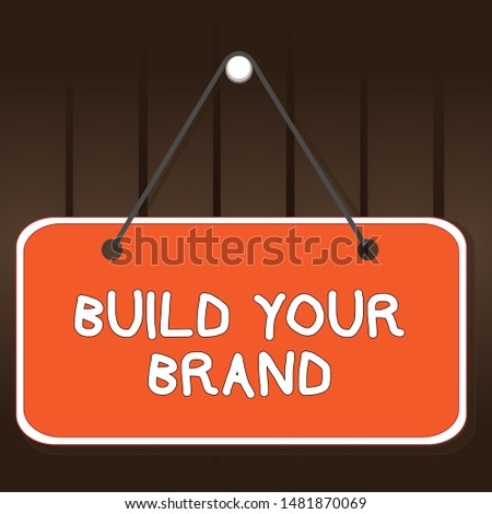 Writing note showing Build Your Brand. Business photo showcasing enhancing brand equity using advertising campaigns Memo reminder empty board attached background rectangle.