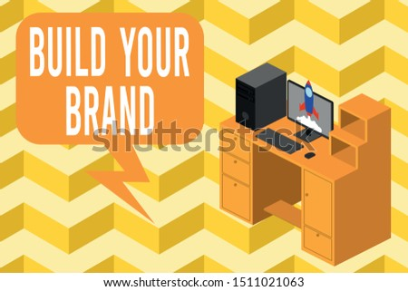 Writing note showing Build Your Brand. Business photo showcasing enhancing brand equity using advertising campaigns Desktop station drawers personal computer launching rocket.