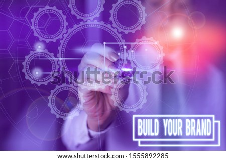 Writing note showing Build Your Brand. Business photo showcasing enhancing brand equity using advertising campaigns Picture photo network scheme with modern smart device.