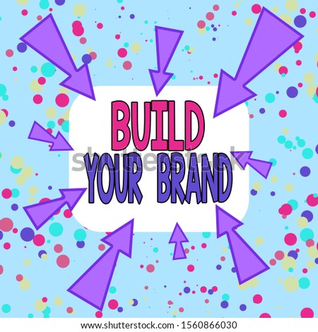 Writing note showing Build Your Brand. Business photo showcasing enhancing brand equity using advertising campaigns Asymmetrical uneven shaped pattern object multicolour design.