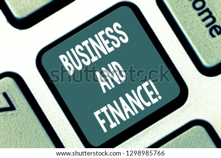 Writing note showing Business And Finance. Business photo showcasing Management of assets and money of an organization Keyboard key Intention to create computer message pressing keypad idea. #1298985766