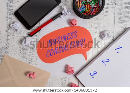 Writing note showing Business Consulting. Business photo showcasing Blends Practice of Academic Theoretical Expertise Smartphone pen clips envelope sheet speech bubble paper balls notebook.