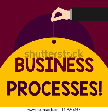 Writing note showing Business Processes. Business photo showcasing Methods practices involves in running a commerce Man hand hold big paper tie string thumb and index finger.