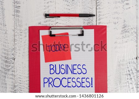 Writing note showing Business Processes. Business photo showcasing Methods practices involves in running a commerce Clipboard paper sheet sticky note ballpoint vintage wooden background.