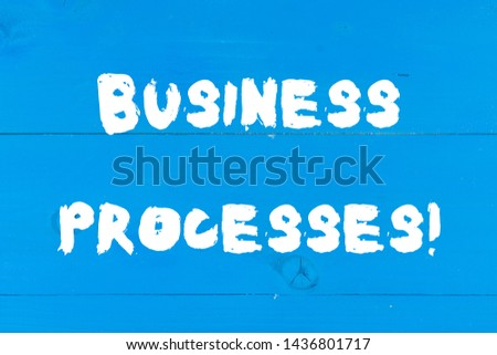 Writing note showing Business Processes. Business photo showcasing Methods practices involves in running a commerce Wooden texture old vintage background horizontal boards holes.