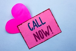 Writing note showing  Call Now. Business photo showcasing Contact Talk Chat Hotline Support Telephony Customer Service written on Pink Sticky Note Paper on the Plain background with Heart.