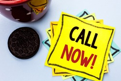 Writing note showing  Call Now. Business photo showcasing Contact Talk Chat Hotline Support Telephony Customer Service written on Yellow Sticky Note Paper on the plain background Cup.