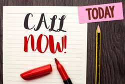 Writing note showing  Call Now. Business photo showcasing Contact Talk Chat Hotline Support Telephony Customer Service written on Notebook Paper on the Wooden background Today Marker Pencil.