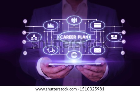 Writing note showing Career Plan. Business photo showcasing ongoing process where you Explore your interests and abilities Male wear formal suit presenting presentation smart device.