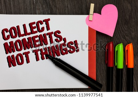 Writing note showing Collect Moments, Not Things. Business photo showcasing Happiness philosophy enjoy simple life facts Bold red words pen on page small heart corner pens laid serially. #1139977541