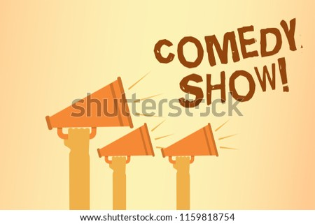 Writing note showing Comedy Show. Business photo showcasing Funny program Humorous Amusing medium of Entertainment Hands holding megaphones loudspeakers important message speaking loud.